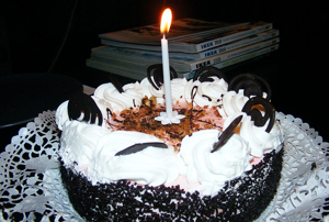 A birthday cake with one candle by Hatem Riahi
