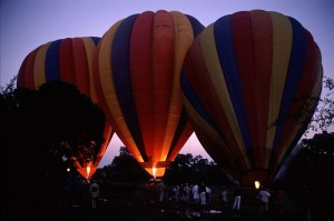 Three hot air balloons being filled.