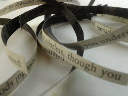 unspooled tape with words on it
